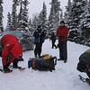 Tying up snowshoes.  Temperature is about zero degrees and we are greatful for the warmup.