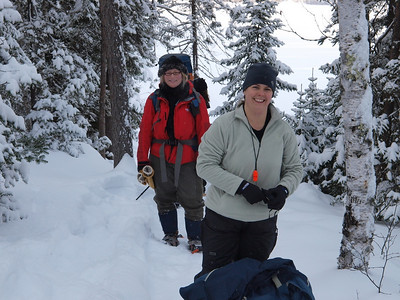 Lisa and Jane pausing on portage to Parent Lake.   Enthusiasm runs high early in the day.
