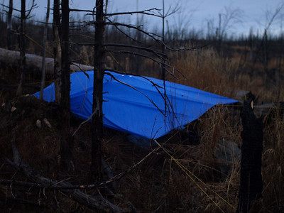 I stopped at dusk and set up my brand new Cooke Custom Sewing 10 x10 foot tarp  (http://www.cookecustomsewing.com/).  Unlike tents, tarps don't have condensation problems and it is safe to start a stove underneath.