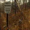 """Note the charred post.  Sign has probably been replaced.  No more signs for next 36 miles.  McKenzie Maps provided me with indispensable set of maps for the trip.  <a href=""""http://www.bwcamaps.com/"""">http://www.bwcamaps.com/</a>"""