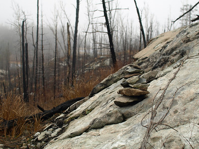 Rock cairn marks the trail.  Looking for cut logs or tamped down grass were other ways of spotting the path.