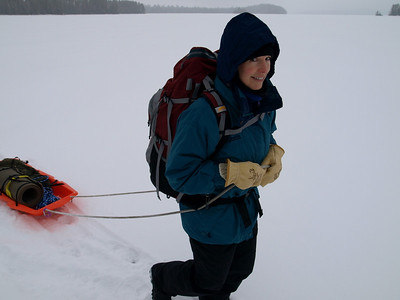 Karen is pulling a sled with emergency foam pad, rope, and the tool bag.  The tool bag has cross cut saw, bow saw, and loppers.