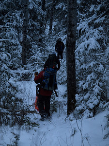 "The BWA Committee crew is heading out.  It will take us 2.5 hours of travelling in dark to reach the public landing on Snowbank.  We took the Kubik ""shortcut"" to Parent Lake, and aiming-off bearing to Snowbank portage in a blinding snow storm.  Crew performed admirably under duress and we reached the landing at 7 pm."