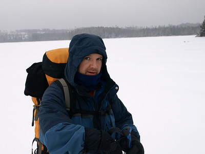 Shawn was our leader for the way in.  Shawn's job was to tap, tap-tap, with a hiking pole to sound for ice thickness.  Earlier we chiseled a hole more than five inches deep in ice without hitting water.  That was thick enough.  For safety, we kept 5 yard distance.