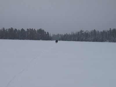 Soon the crew almost disappears in the vast space of Snowbank Lake.