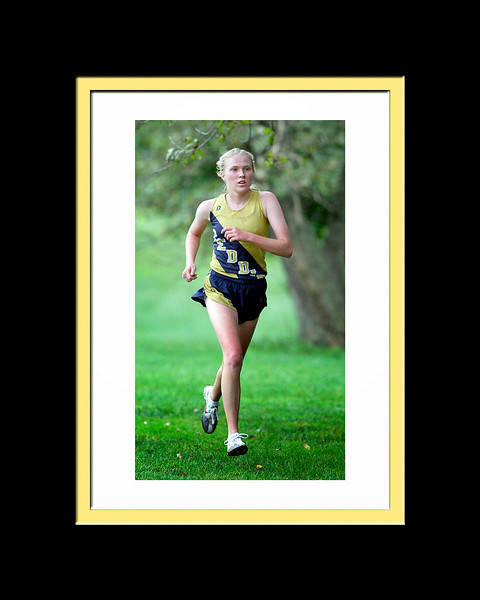 Kelly Bailey of  Peddie School comes in first in the girls cross country meet against George School, Stuart and PDS, in Hightstown, September 16, 2009.  Beverly Schaefer/For The Times