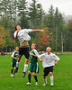 Kennett Eagles defender, Daniel Garner, leaps high for a corner kick, while teammate, Kurt Niiler (right), and Kingswood HIgh players, Jacob Vekos (#13), and Jack Bowen (#7), look for a deflection, during their September 28th match at Kennett High in North Conway. The Eagles defeated Kingswood, 7-1, in the rain soaked contest.