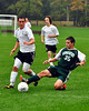 A Kingswood defender makes a side tackle from a Kennett High attacker, during the September 28th match, which Kennett went on to win 7-1, at their home, North Conway, campus.