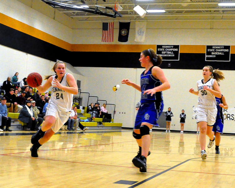"""Melissa Frase, 5'7"""" junior of the Kennett High School Eagles, streaks toward the basket, as Oyster River co-captain Danielle Walczak, tries to close the door, during the February 25th game with Oyster River. The Eagles went on to defeat the visiting Bobcats 62-56."""
