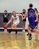 Kennett Eagles junior Melissa Frase, dribbles the ball up court, as Oyster River guard, Riley Maynard (#34), moves in, during the February 25th game which the Eagles defeated the visiting Bobcats,62-56.