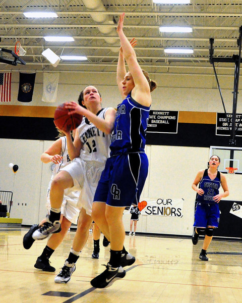 Allie Wagner, junior guard of the Kennett Eagles, makes contact with Oyster River co-captain, Bekah Schuman, while driving toward the basket, during the February 25th game, which the Eagles went on to defeat the visiting Bobcats 62-56.