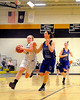 Melissa Frase, of the Kennett Eagles, tries to power her way past Izzy Gorham, of the visiting Oyster River Bobcats, during the February 25th game, which the Eagles went on to win 62-56.