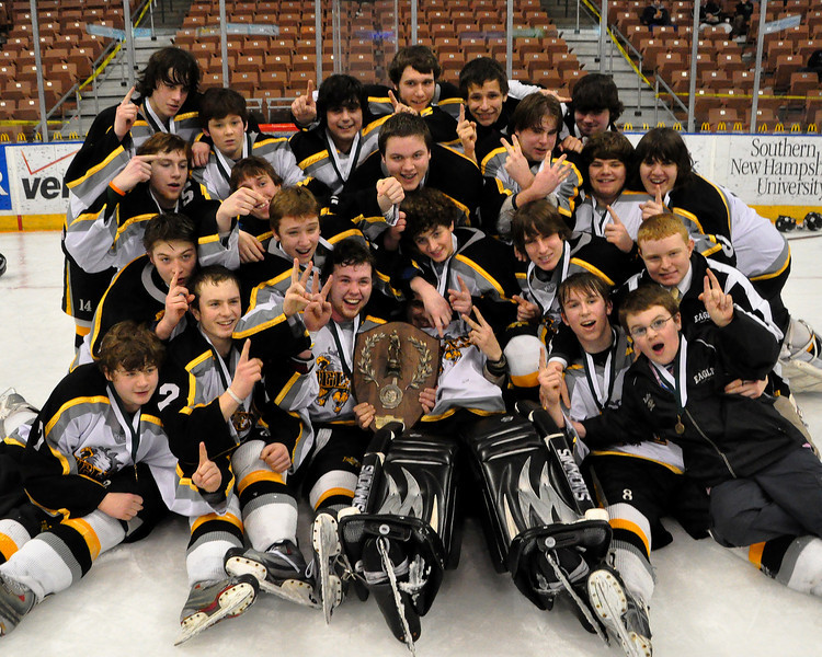 Kennett High School Eagles players celebrate after defeating the Bedford Bulldogs, 2-1, at the Verizon Wireless Arena, in Manchester, NH, to win the 2009-2010 NHIAA Division 3 Boys Ice Hockey Championship, on March 13th, 2010.