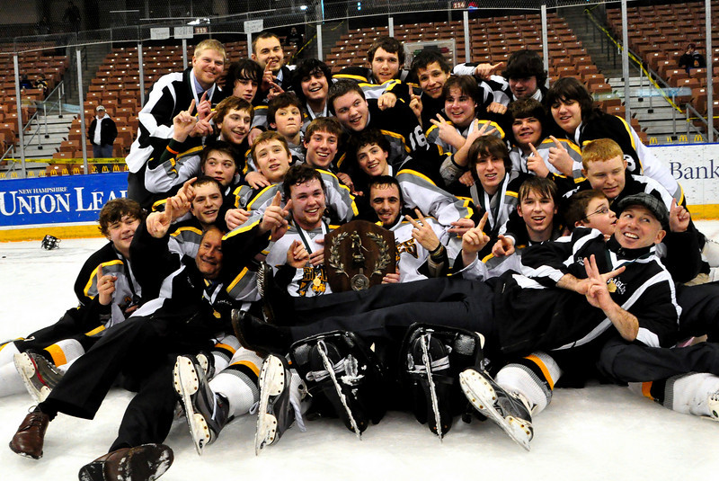 Players and coaches pose with their 2nd championship plaque after the Kennett High School Eagles defeated the Bedford Bulldogs, 2-1, at the Verizon Wireless Arena, in Manchester, NH, and won the 2009-2010 NHIAA Division 3 Boys Ice Hockey Championship, on March 13th, 2010.
