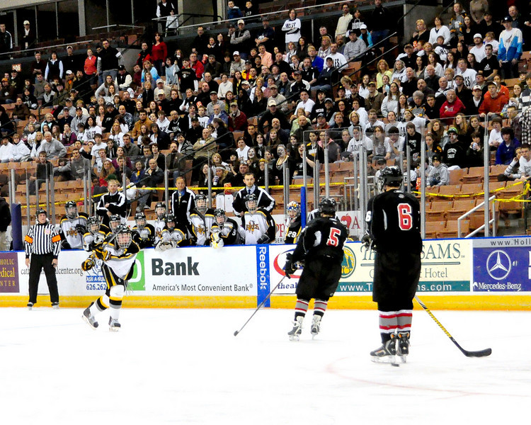 Kennett High School Eagles co-captain Bryan Lamontagne, follows through after unleashing a slap-shot, during the 2010 NHIAA Division 3 Boys Hockey Championship Game. The Kennett High School Eagles went on to defeat the Bedford Bulldogs, 2-1, and successfully defend their 2009 championship. The event was played at the Verizon Wireless Arena, in Manchester, NH, on March 13th, 2010.