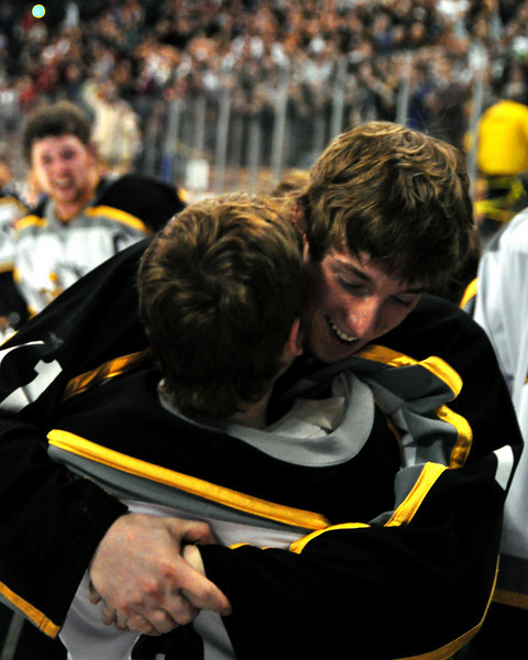 Kennett High School Eagles teammates hug in celebration, after defeating the Bedford Bulldogs, 2-1, at the Verizon Wireless Arena, in Manchester, NH, to win the 2009-2010 NHIAA Division 3 Boys Ice Hockey Championship, on March 13th, 2010.