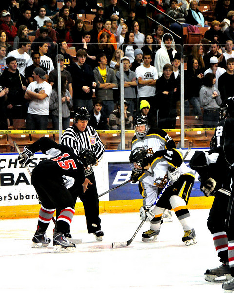 Kevin Murphy, of Kennett High, faces off aganst Bedford's Trevor Sonovick, during the NHIAA Division 3 Boys Hockey Championship Game.  The Kennett High School Eagles defeated the Bedford Bulldogs, 2-1, at the Verizon Wireless Arena, in Manchester, NH, to win 2010 NHIAA Division 3 Boys Ice Hockey Championship, on March 13th, 2010.