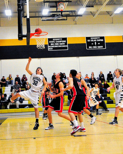 Kennett Eagle forward Matt Lautenschlager (#32) moves through a bunch of Berlin Mountaineers for a layup, during a January 12th game, held at Kennett High School in Redstone. Berlin defeated the Eagles by a score of 66-48.