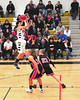 Brandon Frost, Kennett Eagles guard, puts up an outside shot in front of Berlin High's Jason Mercier (#34) and Curtis Arsenault (#23), during their January 12th game, held at Kennett High in Redstone. The Mountaineers from Berlin prevailed 66-48.