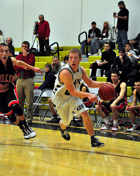Matt Ashnault, guard for the Kennett High Eagles, gets around Sam Aldrich of Berlin High School, during their January 12th game, in which Berlin went on to defeat the Eagles 66-48.