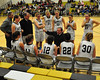 Kennett High School Girls Basketball Head Coach Peter Ames speaks with his team during a timeout during their January 20th game vs Berlin. The Eagles went on to victory 60-28.