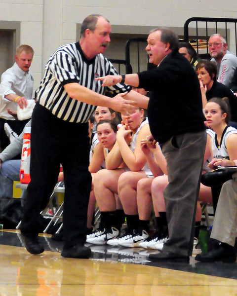 Kennett Eagles Head Coach, Peter Ames, expresses his point of view to an official, during the NHIAA girls basketball division 2, first round tournament game, between Kennett High School, and St. Thomas Aquinas, on March 1st, 2011, at Kennett High School, in North Conway. The Eagles went on to defeat the Saints, 54-46, and move on to the quarter-final round.