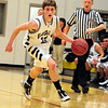 Kennett Eagles junior guard, Alex Milford, brings the ball upcourt, during a January 13th game vs. the visiting Merrimack Valley Pride. Merrimack went on to score a 66-52 victory over the Eagles.
