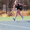 Casey Blakely, of the Kennett Eagles, stretches to hit a forehand return to her Laconia High opponent, during the Eagles first match of the season, on April 14th, 2011. The visiting Sachems defeated the Eagles 7-2.