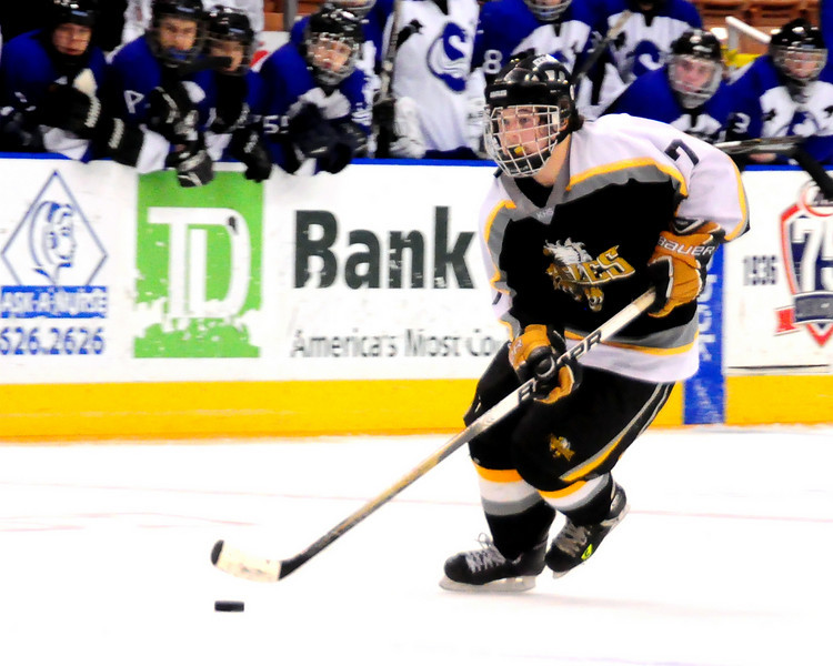 Kennett Eagles sophomore Dillon Smith, carries the puck early in the NHIAA Division 3 Ice Hockey Championship Game, vs. Somersworth, at The Verizon Wireless Arena, in Manchester, NH, on March 13th, 2011. The Eagles fell short to the Hilltoppers, by a score of 8-3.
