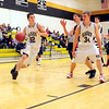 Dustin Stewart, (#34 right), of the Kennett Eagles, blocks out a Merrimack Valley High School defender, leaving teammate Matt Lautenschlager, a clear path to the basket, during a January 13th, home game. The visiting Pride went on to score a 66-52 victory over the Eagles.