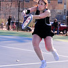Erika Szekely, of the Kennett Eagles, prepares to hit a backhand shot to her Laconia High opponent, during the Eagles first match of the season, on April 14th, 2011. The visiting Sachems defeated the Eagles 7-2.