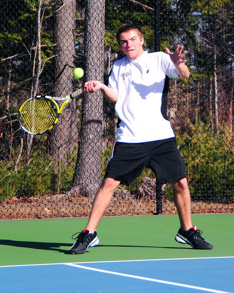 Oren Bentley, of the Kennett Eagles, hits a forehand return to his Bishop Brady opponent, during an April 15th match at Kennett High School in Redstone. The Eagles were defeated 9-0, to the visiting team from Concord.