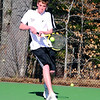 Tyler Butler, of the Kennett Eagles, hits a backhand shot to his Bishop Brady opponent, during an April 15th match at Kennett High School in Redstone. The Eagles were defeated 9-0, to the visiting team from Concord.