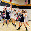 Kennett Eagles junior forward, Casey Blakely (#14), and St. Thomas Aquinas forward, Natalie Michaud, jump for a loose ball, during the NHIAA girls basketball division 2, first round tournament game, on March 1st, 2011, at Kennett High School, in North Conway. The Eagles went on to defeat the Saints, 54-46, and move on to the quarter-final round.