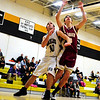 Sean Perley (#10 left), Kennett Eagles forward, jockeys for position with a Portsmouth High defender, during a February 11th, 2011 game at Kennett High School, in North Conway, NH. The Eagles went down to defeat by a score of 77-22.