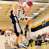 Alex Milford (right), junior guard for the Kennett Eagles, rises toward the basket, as he collides with a Merrimack Valley defender, during a January 13th. game, held at Kennett High School. The Eagles were defeated 66-52, by the visiting Pride.
