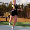 Casey Blakely, of the Kennett Eagles, hits a return shot to her Laconia High opponent, during the Eagles first match of the season, on April 14th, 2011. The visiting Sachems defeated the Eagles 7-2.