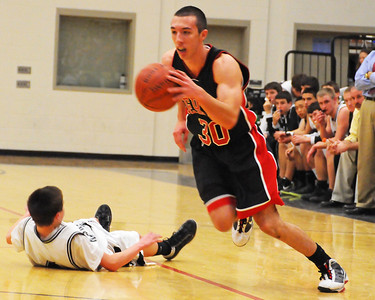 Berlin High School guard, Sam Aldrich, moves past a Kennett High School defender, during a January 10th, 2012, game played at Kennett High School in Redstone. The visiting Mountaineers defeated the Eagles 78-56.