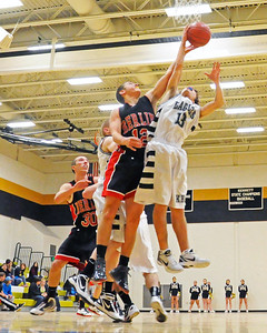 Seth Davison (right), of the Kennett Eagles, and Berlin High School forward, Zack Bacon, fight for a rebound, during a January 10th, 2012, game played at Kennett High School in Redstone. The visiting Mountaineers defeated the Eagles 78-56.