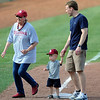 "Kids of all ages got to run the bases at L. Dale Mitchell Park Sunday, May 13, 2012, following OU's 3-game sweep this weekend of No.2 ranked Baylor. Rounding third base are Patsy ""Lumber Lady"" Shelly and Paul Munding and his 2-year-old son, Luke. The Sooners are back in action Tuesday when they host TCU. Photo by Jerry Laizure"