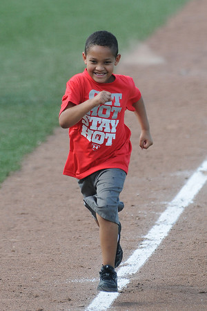 Kids were allowed to run the bases at L. Dale Mitchell Park Sunday, May 13, 2012, following OU's win over Baylor. Photo by Jerry Laizure