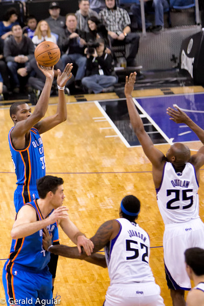 """Kevin Durant with one of his jump shots outside the key.  He is listed at 6'9"""" and outlaw is close to 6'11'."""