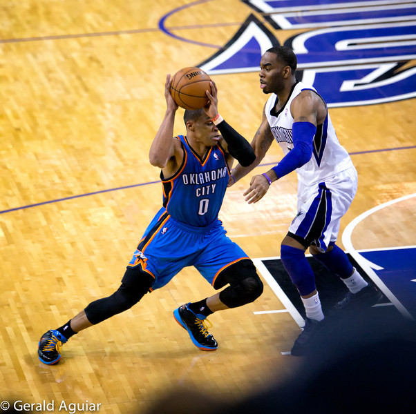 Westbrook driving to the basket.  Notice the angle and pressure on his right ankle and the determination on his face to get around the King defender.