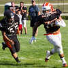 Record-Eagle/Brett A. Sommers Kingsley running back Nelson Rodriguez bounces a run to the outside during Thursday's scrimmage at Rodes Field.