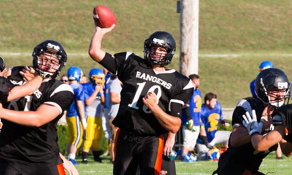 Record-Eagle/Brett A. Sommers Manton quarterback Wyatt Baker passes during Thursday's scrimmage at Rodes Field.