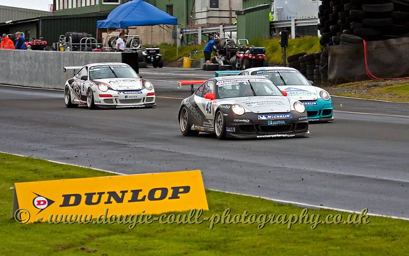 Three Porsches Charge Down the Straight