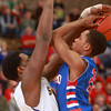 3-15-14<br /> Kokomo Regional Game against Homestead<br /> Kokomo's Mykal Cox goes up for a shot as Homestead's Caleb Swanigan tries to block him.<br /> KT photo | Kelly Lafferty