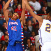 3-7-14<br /> Kokomo vs. Marion basketball<br /> Kokomo's Demarius Warren jumps up for a shot.<br /> KT photo   Kelly Lafferty