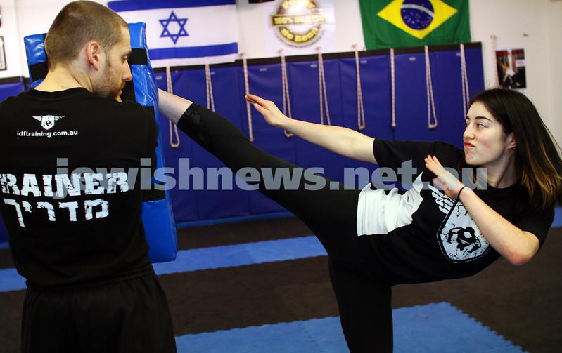 11-6-12. Krav Maga instructor Melinda Slonim warming up before taking a women's session. Photo: Peter Haskin