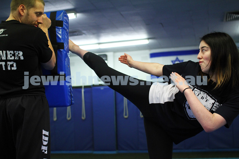 11-6-12. Krav Maga instructor Melinda Slonim warming up before taking a women's session. Photo: Peter Haskin